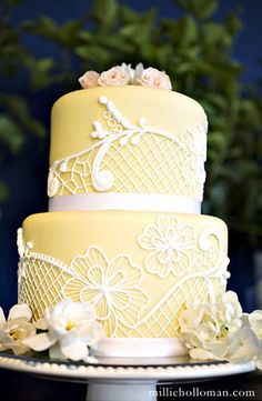 yellow cake with white piping