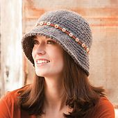 A simple chain-stitch band attached with pretty buttons gives a plain hat a touch of pizzazz.