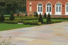 Raj Green Sandstone Paving has a vibrant blend of grey, green, brown, red and even purple tones. This makes it one of our more versatile products as it compliments a wide variety of brick colours so it's suitable for almost any home.