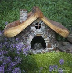 Toad houses, made for actual use in the garden. People buy these houses for bull frogs to live in around their ponds. So cute, see toad looking out!!
