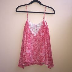 Patterned Tank Top A lightweight, light red, beautifully detailed paisley patterned tank top. Originally purchased from Francesca's. Blue Rain Tops Tank Tops