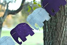 Could easily make this with giraffes. Purple and Gray Elephant Felt Garland by DovDesigns on Etsy, $14.00
