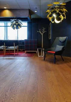 Oak Classic Cognac, brushed hard wax oiled in hotel lobby area, Hotel Cumulus, Jyväskylä, Finland. Lobby Bar, Hotel Lobby, Wooden Flooring, Finland, Floors, Wax, Around The Worlds, Classic, Table