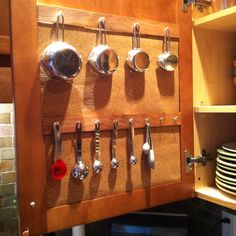 Organize those hard to find things! Paint stir sticks, small cup hooks, command strips!
