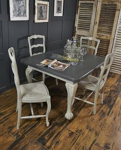 This ball and claw foot dining table & French straw seat chairs is perfect for Christmas! Painted in Annie Sloan Paris Grey with Old White Detailing, with the table top in Valspar Carriage Wheel. http://www.thetreasuretrove.co.uk/tables/paris-grey-shabby-chic-4-seater-dining-set-on-castors