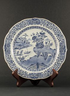 Qianlong - Blue and white export plate with religious decor of Vajra rocks and river scene, marked with an inverse seal mark to the reverse