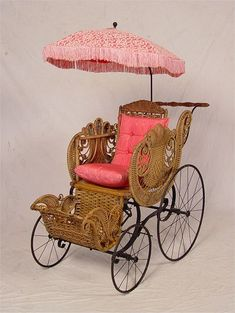 Victorian wicker baby buggy with parasol to match