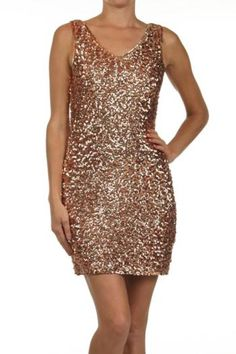Light up the night with the Spark Dress. Stunning tank sequin dress featuring v-neck and low back. Style with fun earrings and heels for an electric going out look.