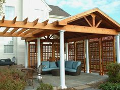 Image from https://archadeckwestcounty.files.wordpress.com/2016/01/covered-patio-by-archadeck-pergola-and-roof-structure.jpg.