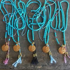 """BABY TURQUOISE GANESH MALAS  Available with baby blue, pink or black silk.  These slip over the head to sit 24"""" (LAKSHMI ON BACK SIDE)  Solid 18K Yellow gold with Grade AA Navajo Turquoise   This is the MANIFESTATION & EXPANSION MALA.  #iloveshakti #shaktifinejewelry  www.iloveshakti.com"""