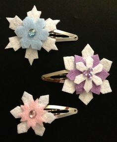 Inspired from Disneys new movie Frozen. Listing includes a set of THREE barrettes.  Layered and topped with rhinestones.    All of our