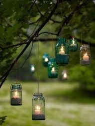Hanging tea lights in the trees