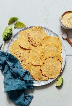 EASY corn tortillas with just 2 ingredients required! Tips for making with and without a tortilla press. The perfect side for Mexican night! Mexican Dishes, Mexican Food Recipes, Snack Recipes, Dinner Recipes, Vegan Recipes, Vegetarian Mexican, Spanish Recipes, Detox Recipes, Free Recipes