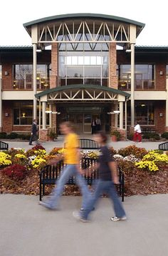Students walk in front of the Eastway Center, a hub of dining and entertainment for students.