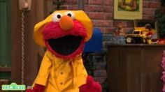 Sesame Street: Elmo's Jumping In Puddles.  Too bad overboots don't come in Muppet sizes, Elmo could use a pair!