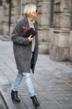 Stand out among other stylish civilians in a dark grey coat and light blue jeans. A pair of black leather ankle boots will seamlessly integrate within a variety of outfits.  Shop this look for $122:  http://lookastic.com/women/looks/crew-neck-sweater-clutch-clutch-coat-jeans-ankle-boots/4865  — Grey Crew-neck Sweater  — Brown Leopard Leather Clutch  — Black Leather Clutch  — Charcoal Coat  — Light Blue Jeans  — Black Leather Ankle Boots