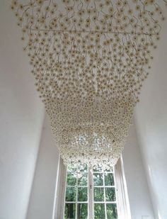 Suspended dandelions - wouldn't this be AMAZING?!  Yes, they are REAL!