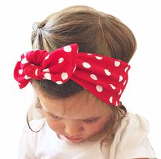1 Red with White Polka dot baby head wrap   These top knot head wraps are the newest fashion trend! Your little one will look absolutely ADORABLE in this! It is a very stretchy & soft material that can be untied and retied to fit your child's head comfortably  Please allow 2-3 business days for processing (The estimated time between purchase date and ship date) We ship using USPS first class mail (3-5 business days). Processing time may be longer if ordered with other headbands.  -We offer…