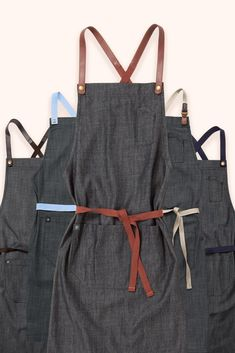 One Apron - Many Looks ⭐️ Our Henry Bib Apron in Charcoal is the long standing favourite of the Cargo Crew Apron range. Worn by over 70,000 staff worldwide in every industry, the Henry offers timeless style that will work as hard as you do with it's hardwearing linen-look Fight The Fade™️ fabric. Henry comes with your choice of apron strap so you can perfectly customise the look and feel of your new uniform🙌 | Cafe Apron | Barista Apron | Restaurant Apron Cafe Apron, Restaurant Aprons, Name Embroidery, Embroidery Services, Bib Apron, Apron Designs, Pink Fabric, Barista, Denim Shirt