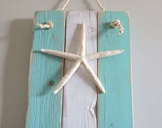 Items similar to Starfish Ocean Decor turquoise white nautical wall hanging boat cleat hooks recycled beach decor upcycled seashore ocean on Etsy : Love this nautical seaside hanger Seashell Crafts, Beach Crafts, Deco Marine, Boat Cleats, Beach Room, Kitchen Decor Themes, Beach Cottages, Beach Houses, Beach House Decor