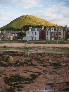 The volcanic mass of North Berwick Law stands tall above the town, and in front the seafront promenade threads Victorian seaside villas tight beside the beach.