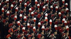 A marching band performs before the introduction of the new pope. Anyone know what band and why there colors?
