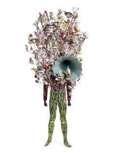 Nick Cave. Soundsuit. ; found objects, knit head and bodysuit, and mannequin. 2011  art