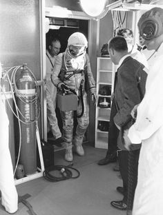 "Astronaut Alan B. Shepard, Jr., makes his way from the elevator to the cleanroom atop the service tower where he'll be inserted into his Mercury space capsule nicknamed ""Freedom 7."" (Great Images in NASA)"