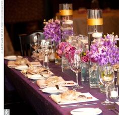 The Reception Decor Varied flower arrangements, some filled with water and floating candles, topped the purple tables Reception Table, Reception Decorations, Reception Ideas, Table Decorations, Wedding Flower Arrangements, Wedding Flowers, Centerpiece Wedding, Table Arrangements, Centerpiece Ideas