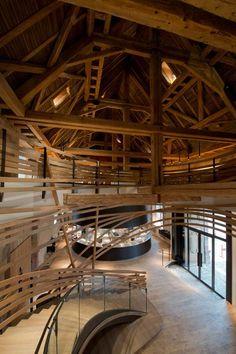Wooden-strips-coil-around-staircase-at-Strasbourg-hotel-by-Jouin-Manku_ellizoe_5