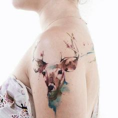 Watercolor style deer on the right shoulder. Tattoo Artist: Victor Octaviano