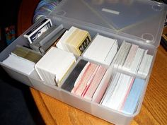 Consolidate card games into a single plastic tote and throw away the bulky boxes.