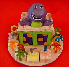 """Barney cake! Adorable and could give each kid their own little """"cake"""" to eat at the party"""