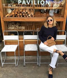 Summer day outfit with round sunglasses, espadrilles and cropped white jeans