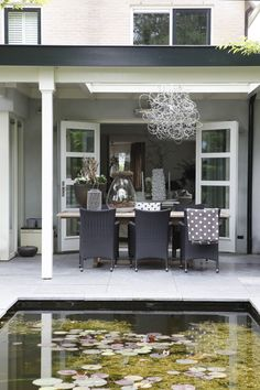 Lovely veranda, perfect for alfresco dining. I like the pond and the high contrast color palette