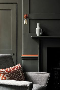love these dark green walls and fireplace in living room with pop of orange by Little Greene. Click through for more green paint colours you'll love Dark Green Living Room, Dark Green Walls, Colourful Living Room, Beautiful Living Rooms, Black Walls, Green Paint Colors, Room Paint Colors, Paint Colors For Living Room, Wall Colours