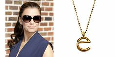 Eva Longoria was spotted traveling in style wearing her Ariel Gordon 14k gold E initial necklace with diamond.