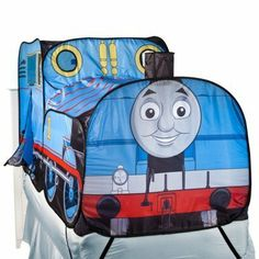 """Thomas the Train Bed Topper and Tent by play hut. $99.99. Bed Topper Features: Corner Anchor Loops     Number of Pieces: 1     Fiber Content: 100 % Polyester     Care and Cleaning: Spot Clean Only     Closure Type: Hook and Loop     Dimensions: 74.0 """" L x 37.0 """" W"""