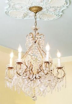 gorgeous. love the ceiling medallion and color.