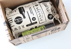 Packaging for craft candle brand Rewined including custom boxes and cloth bags designed by Stitch.