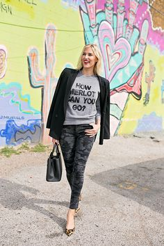 Throw a blazer over a statement sweatshirt for a dressier look. Pair it with skinny jeans (or camo print jeans if you've got them!) and a leopard print heel! Click through for details on this look.