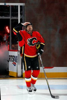 Home opener - Flames vs. Canucks - Brian McGratton salutes the fans, again. Ice Hockey Teams, Hockey Stuff, Sheffield Steelers, Hockey Posters, National Hockey League, Sport Quotes, Calgary, Nhl, Sweatshirts