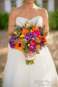 bright orange pink and purple bouquet with peacock feather accents by Pure Luxe Bride Jewel Tone Wedding, Wedding Colors, Wedding Flowers, Wedding Dresses, Fall Flowers, Dock Wedding, Dream Wedding, Wedding Bells, Perfect Wedding