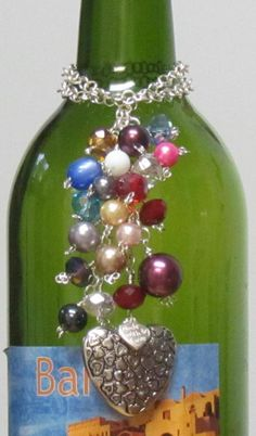 Wine Bottle Charms - A wonderful little beaded gift for a wine lover that can be used time and time again. Classy wine bottle charms are an awesome way to decorate your favorite wine bottle for any special occassion, event, or holidays, or just to add to your personal charm. Perfect one of a kind gifts for those wine connoisseurs.   $15.00