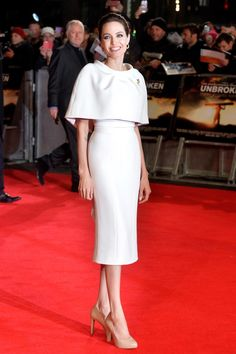 Angelina Jolie wore a custom-made silk-crepe pencil dress with bolero cape by Ralph & Russo Couture.