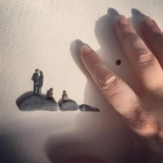 Sometimes it's hard to get the scale of things via a photograph. I've included my hand in this one to help show how tiny some of my pebbles are. #pebbleart #pebbleartist #tiny #perspective #scale #pebbles #stones #rockart #artist #family