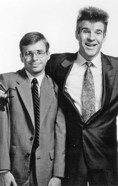 Rick Moranis and Steve Martin in My Blue Heaven, one of my favorite movies. Steve absolutely aced the role of Vinnie, a larger than life mobster with a heart of gold. His great facility with body language shines in this movie. Movie Stars, Movie Tv, Rick Moranis, Steve Martin, Star Show, Important People, Cinema, Celebs, Celebrities