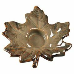 "Ceramic maple leaf-shaped candleholder.   Product: CandleholderConstruction Material: CeramicColor: BrownAccommodates: (1) Tea light - not includedDimensions: 5.5"" H x 5.5"" W"