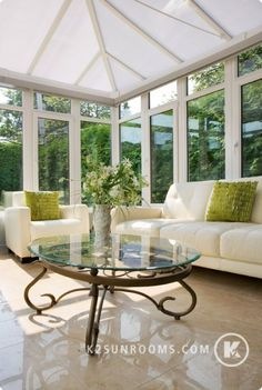 The white color palette serves as a neutral background to make nature pop inside and out. #nature #conservatory #greenery www.conservatoryinfo.co.uk