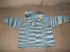 I knit this sweater for a 2 year old. There are dog buttons sewn to the front of the sweater. But between the left and front panel I sewed in snaps.